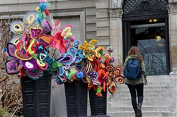 Pop des Fleurs, an installation of colorful flowers made of recycled materials, graces the entrance of the Carnegie Library of Pittsburgh in Oakland. They're a project of the Fiberarts Guild of Pittsburgh.