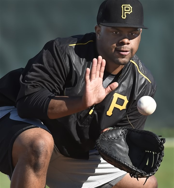 20160217pdPiratesSports05-4 Pirates first baseman Jason Rogers fields a ground ball during morning workouts in Bradenton, Fla.