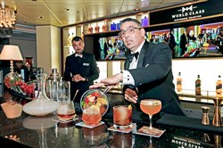 Bartender Julio Cabrera demonstrates the new drinks exclusive to the Celebrity Eclipse cruise ship's World Class Bar.