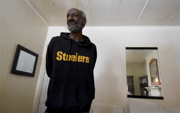 20160224radMealsOnWheelsLocal07-6 Edward Payne, 70, lives in a Deutschtown house without gas heat. Meals on Wheels volunteers Galen Osby and Bill Simmons are his contacts to make sure he's coping in the cold weather.