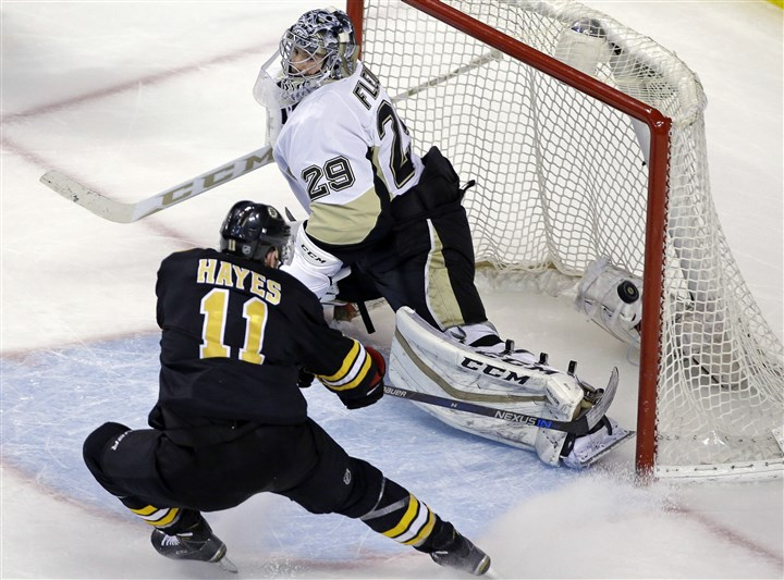 Penguins Bruins Hockey-2 Boston Bruins right wing Jimmy Hayes scores against Penguins goalie Marc-Andre Fleury in the third period.