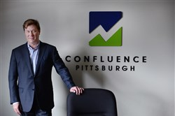Mark Evans, chairman, CEO and president of Confluence, inside the company's North Shore office.