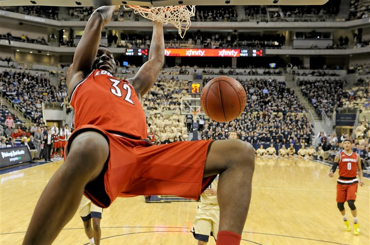 20160224mfpittsports11 Louisville forward Chinanu Onuaku dunks against Pitt in the first half Wednesday at Petersen Events Center.