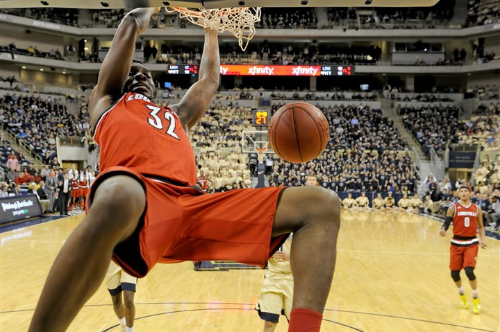 20160224mfpittsports11 Louisville's Chinanu Onuaku dunks against Pitt in the first half Wednesday at Petersen Events Center.