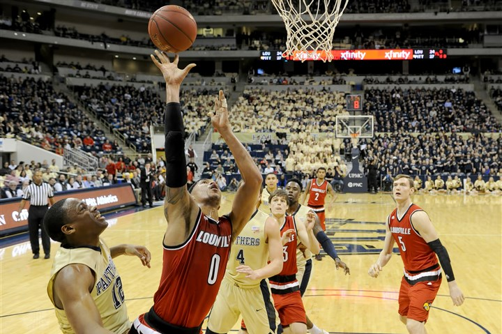 20160224mfpittsports12-1 Louisville's Damion Lee drives to the net against Pitt's Chris Jones in the first half Wednesday at Petersen Events Center.