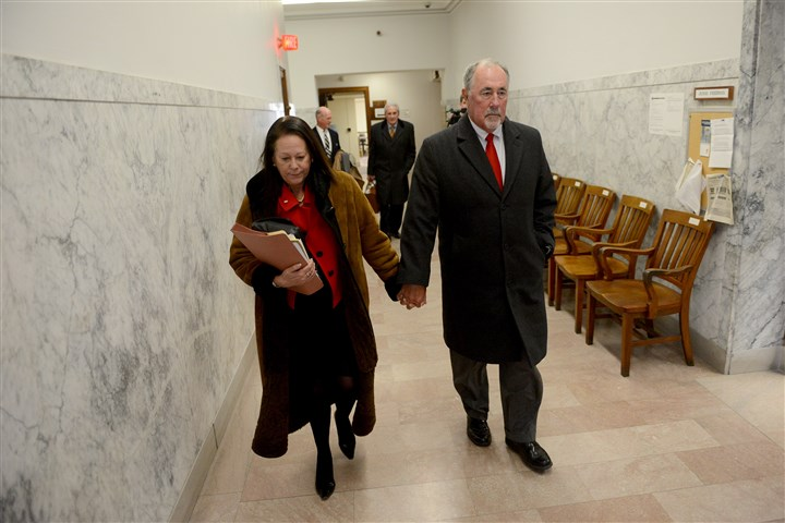 20160225MWHeakinLocal06-5 Pennsylvania Supreme Court Justice Michael Eakin and his wife Heidi Eakin walk through the hallways of the Pittsburgh City County Building on Feb. 25.