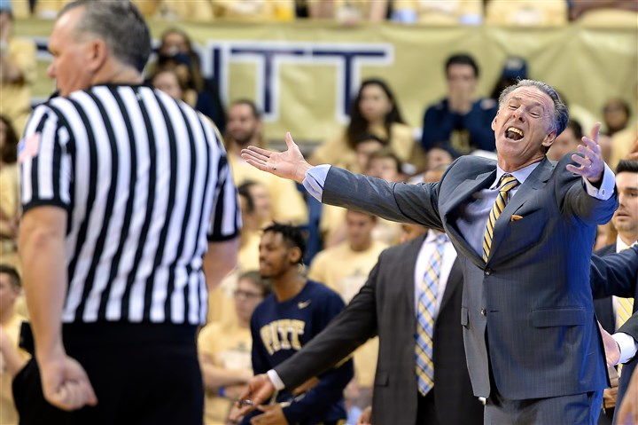 20160224mfpittsports05-4 Pitt head coach Jamie Dixon argues a call against his team as they take on Louisville in the first half Wednesday at Petersen Events Center.