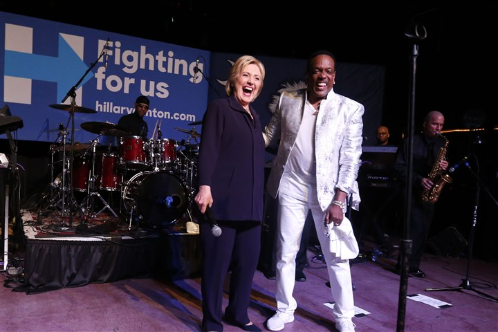 "DEM 2016 Clinton-3 Democratic presidential candidate Hillary Clinton appears onstage with recording artist Charlie Wilson during a ""Get Out The Vote"" concert at The Music Farm in Charleston, S.C., on Thursday."