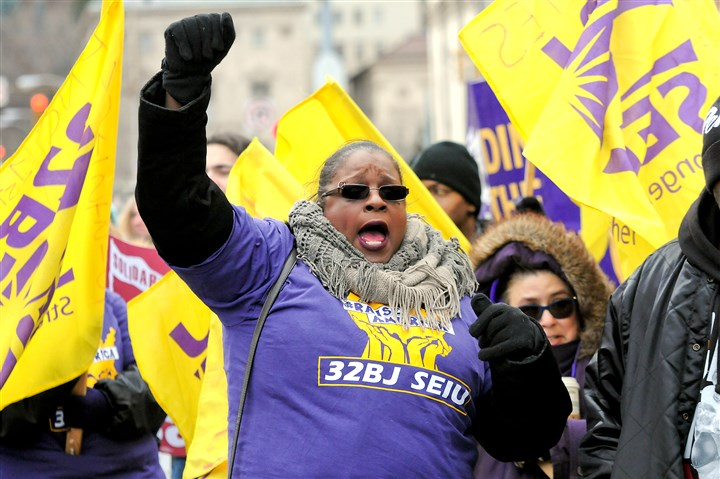 20160226JHProtest02-5 Angelia Kemper, SEIU member and food service worker at Pitt, rallies Friday afternoon near the Cathedral of Learning.