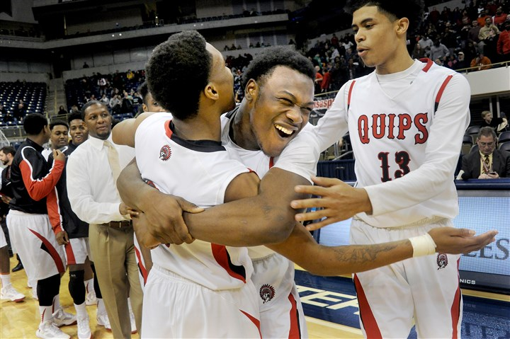 20160227lf-Basketball06-5 Aliquippa's Kaezon Pugh celebrates with teammates.