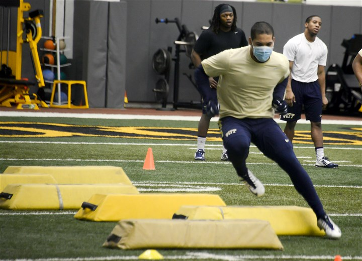 20160226dsPittConnerSpts01 Pitt's James Conner runs through a drill this morning at the Panthers' South Side training facility.
