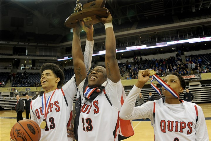 20160227lf-Basketball08-7 Aliquippa's Charles Humphries, Kaezon Pugh and Sheldon Jeter celebrate after defeating Lincoln Park 49-45 in the WPIAL Class AA Boys Championship at Petersen Events Center.