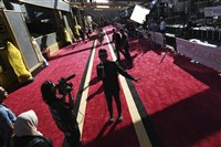 The red carpet at the Academy Awards is long. It can take celebrities about an hour to make it through, stopping to pose for photos and chat with media along the way.