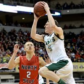 Pine-Richland's Andrew Petcash drives to the basket against North Hills' Nick Smith last season in the WPIAL Class 4A championship game at Petersen Events Center.