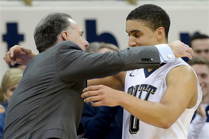 20160228mfpittsports13-2 Pitt head coach Jamie Dixon hugs senior James Robinson as he comes out of the game against Duke in the second half Sunday at Petersen Events Center.