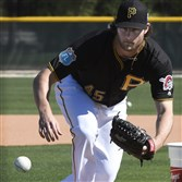 Pirates pitcher Gerrit Cole fields a ground ball this week during a workout at spring training.