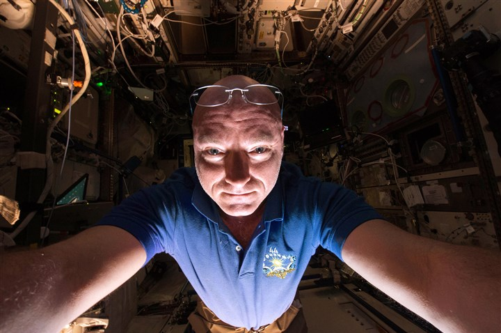 Kelly0229a In this June 14, 2015, photo made available by NASA, astronaut Scott Kelly makes a photo of himself as he prepares a scientific experiment on the International Space Station.