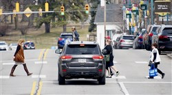 Mt. Lebanon, shown at Washington Road at Cedar Boulevard, is challenging generations of Pittsburgh-area jaywalking by passing an ordinance forcing pedestrians to use crosswalks and mind the traffic lights.