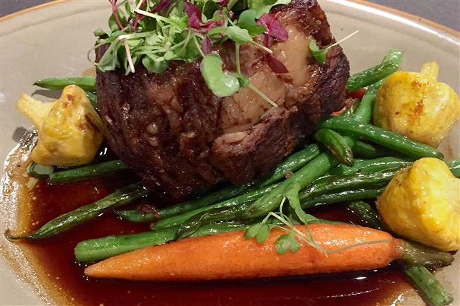 Short rib braised in East End Blackstrap Stout with steamed vegetables at Wallace's Tap Room in the Hotel Indigo in East Liberty.