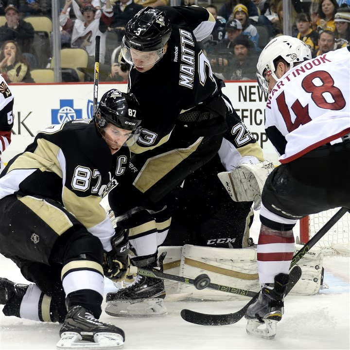 20160229mfpenssports10 Penguins captain Sidney Crosby gets his stick on a shot by the Arizona Coyotes' Jordan Martinook in the second period Monday at Consol Energy Center.