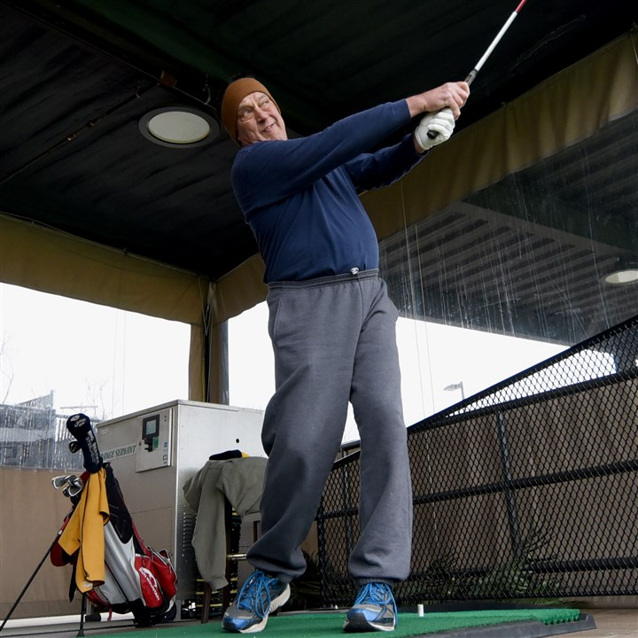 20160303radCoolSpringsZone04-3 John Petechel of Bethel Park hits balls at the upgraded driving range at Cool Springs. The range is covered with two colors of artificial turf, and some stalls feature shot tracker to show golfers immediate feedback on shaping shots.