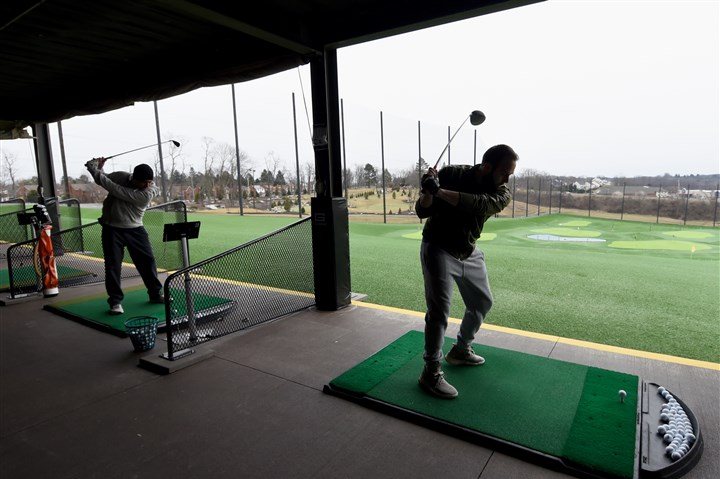 20160303radCoolSpringsZone03-2 Quinn Korno, left, and Dan Kail hit balls at the upgraded driving range at Cool Springs.