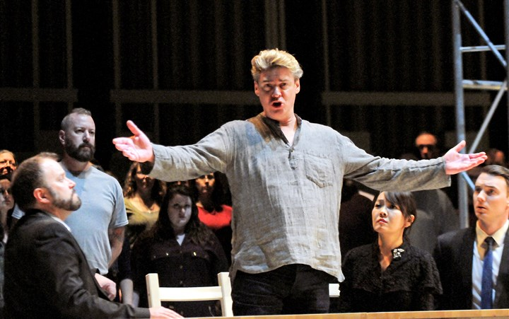 "20160303JHMagBach01 Paul Armin Edelmann, center, portrays Jesus in a rehearsal of Bach's ""St. John Passion"" at Heinz Hall. The PSO's semi-staged production of the monumental work, directed by Sam Helfrich and conducted by Manfred Honeck, opened Friday night."