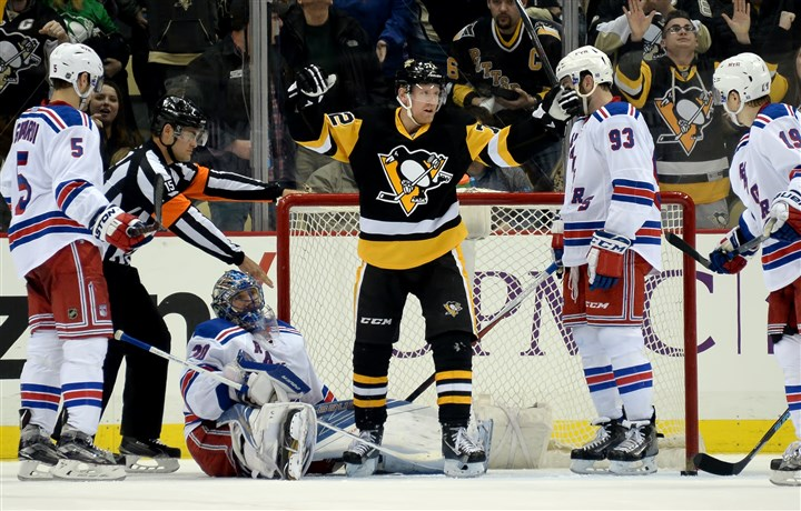 20160303mfpenssports10 Penguins' Patric Hornqvist celebrates a goal by Sidney Crosby against Rangers goaltender Henrik Lundqvist in the second period Thursday at Consol Energy Center.