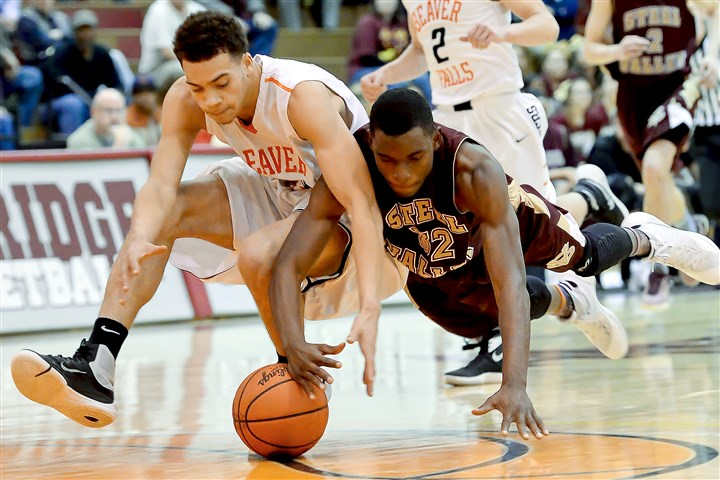 20160304mfbeaversports05 Beaver Falls' Josh Creach and Steel Valley's Amonte Strothers dive for a loose ball Friday night at Ambridge.