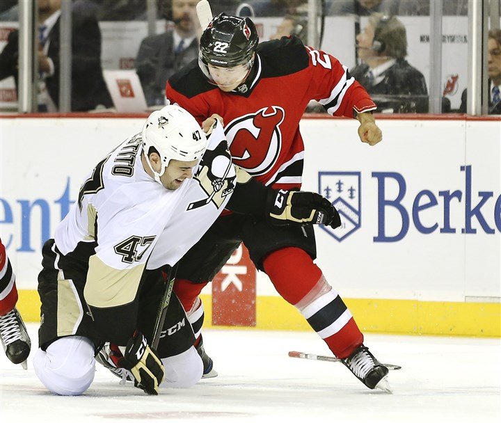Penguins Devils Hockey-3 New Jersey Devils right winger Jordin Tootoo fights with Penguins left winger Tom Sestito, who was called up from the AHL, in the first period Sunday at Prudential Center in Newark, N.J.