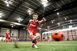 Parker Weiss shoots as Peters' 4-11 boys travel team takes on the Mt. Lebanon Blue Devils in a youth soccer game in the cavernous, FIFA-regulation indoor soccer field at Cool Springs.