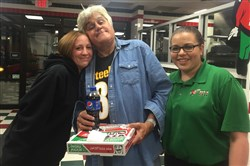 Jet's Pizzeria manager JoAnn Liebro, left, poses with Jay Leno and Jet's employee Bryanna Zembroski last Saturday night.