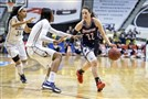 Duquesne's April Robinson drives the ball past George Washington's Brianna Cummings and Caira Washington, center, during an NCAA college basketball championship game in the Atlantic 10 conference tournament in Richmond, Va.
