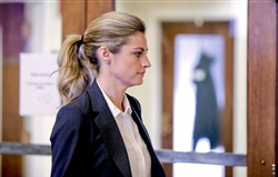 Sportscaster and television host Erin Andrews walks to the courtroom today in Nashville, Tenn.