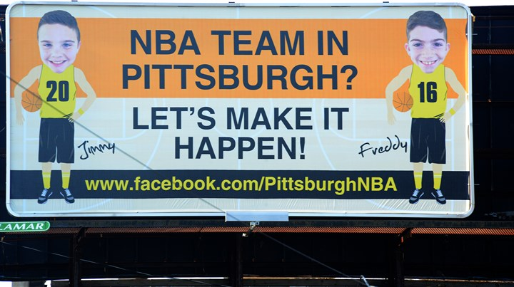20160308lf-NBA02-1 Jimmy Hanna, 11 and his brother Freddy,10, of Fox Chapel, are trying to get an NBA franchise to move to Pittsburgh. They have raised $2,620 on GoFundMe, which they used to rent two billboards, like this one on Washington Boulevard.