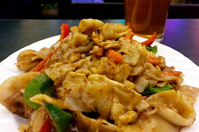A platter of the Pad Satay Noodles with Thai peanut sauce, carrots, broccoli, green and red peppers at Thai Touch Kitchen in Mt. Lebanon.