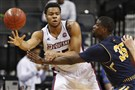 Duquesne forward Jordan Robinson passes around La Salle guard Rohan Brown during the second half of their Atlantic 10 men's basketball tournament matchup.