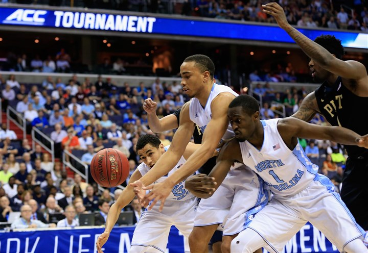 ACC Basketball Tournament - Quarterfinals-5 Brice Johnson and Theo Pinson go after the ball against the Panthers.