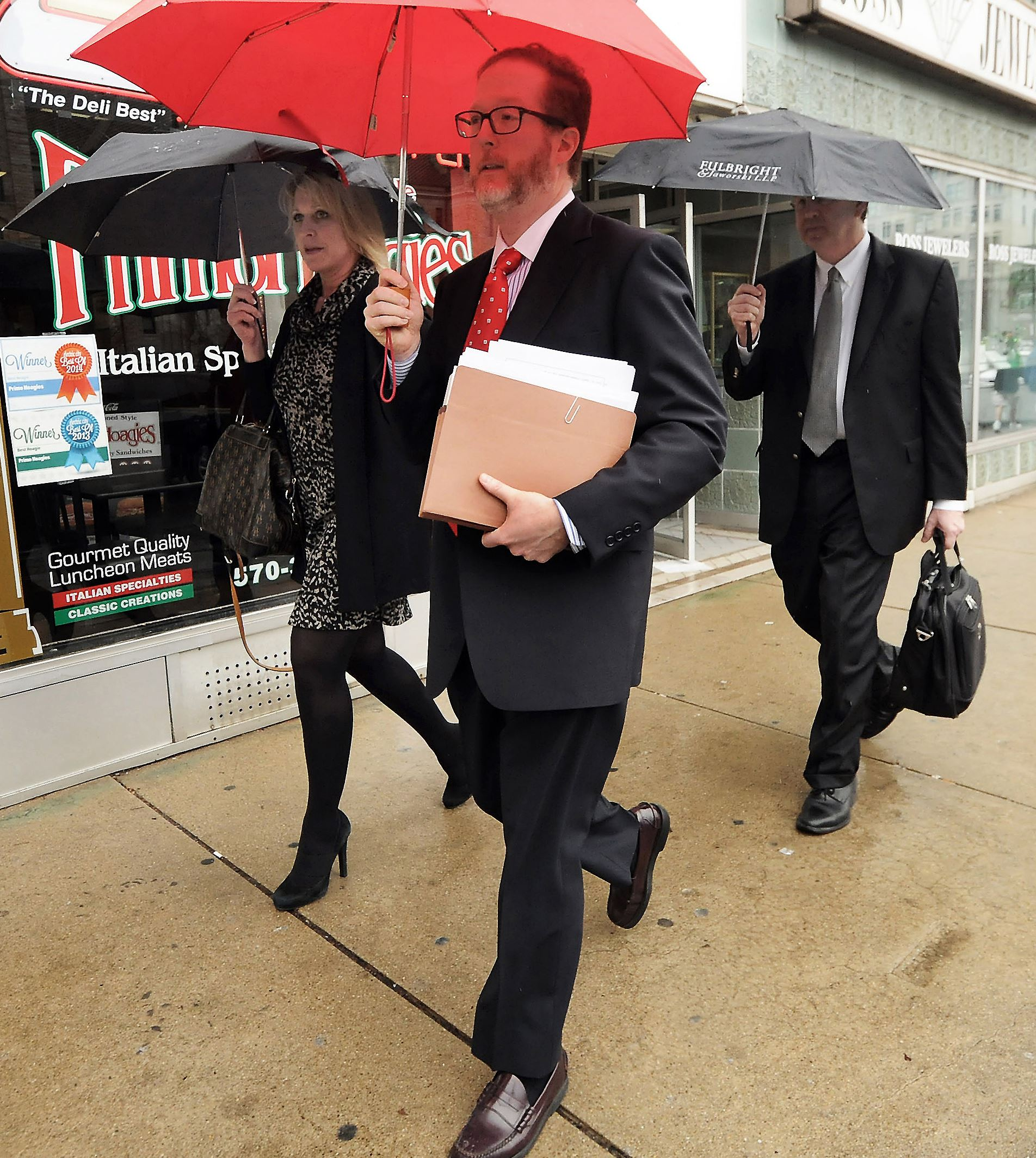 Cabot Oil Settlement-4 Lawyers for Cabot Oil and Gas leave the William J. Nealon Federal Building and U.S. Courthouse in downtown Scranton.