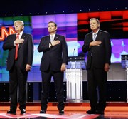 Republican presidential candidates Donald Trump, Sen. Ted Cruz of Texas and Ohio Gov. John Kasich stand together during the singing of the National Anthem before the start of the Republican presidential debate on March 10 in Coral Gables, Fla.