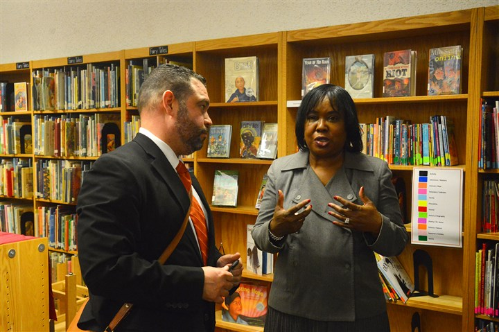 20160311lf-Education02-1 Pedro Rivera chats with Regina Holley, President of Pittsburgh Public Schools at the Pittsburgh King K-8 on Friday.