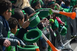 Children wait to get candies at Pittsburgh's annual St. Patrick's Day Parade.