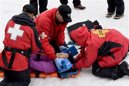 Ski Patrol members take a day long test in several medical emergencies to become a Senior Patroller, here tending to a victim with a simulated head and neck injury from an eight-foot fall at Seven Springs Resort. Senior Patrolers volunteers will again be staffing the Pittsburgh Marathon.