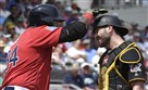 The Pirates' Francisco Cervelli gets a pat on the head from the Red Sox's David Ortiz at JetBlue Park in Ft. Myers, Fla., last spring.