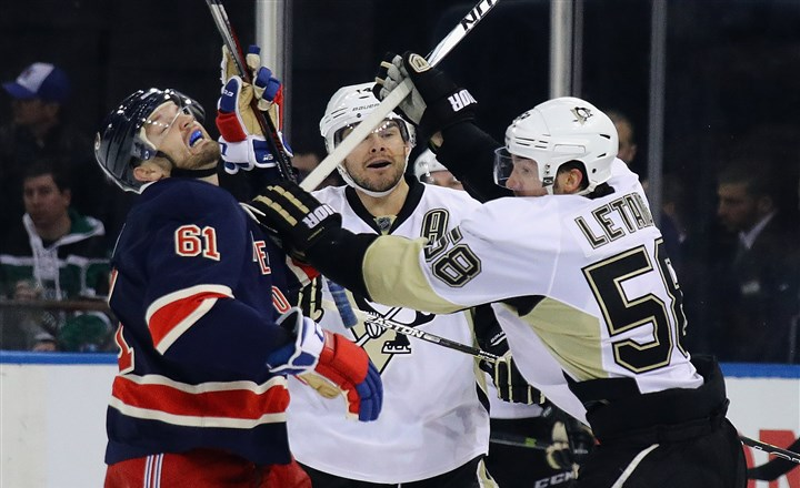 Pittsburgh Penguins v New York Rangers-6 Kris Letang gets the stick up on Rick Nash during the second period Sunday.