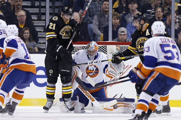 Islanders Bruins Thomas Greiss Boston's Loui Eriksson, left, looks for the rebound off Islanders goalie Thomas Greiss during the first period of Saturday's game in Boston.