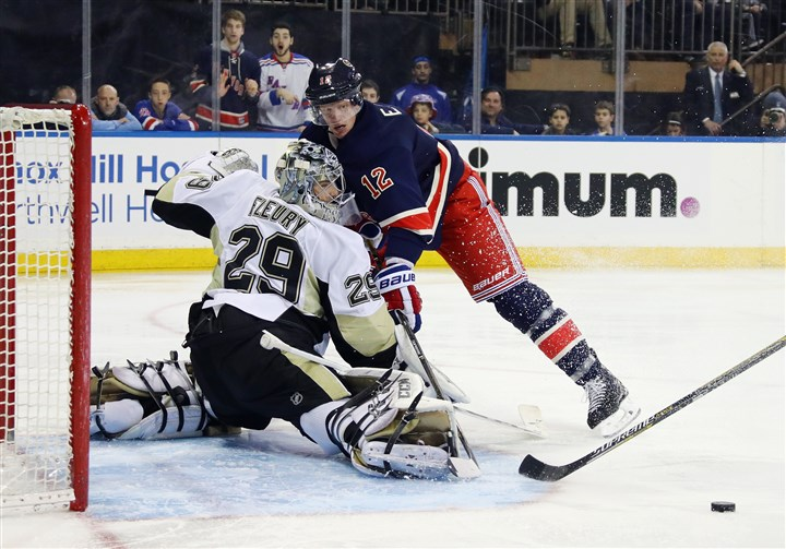 Pittsburgh Penguins v New York Rangers-5 Marc-Andre Fleury makes a second-period save on Eric Staal.