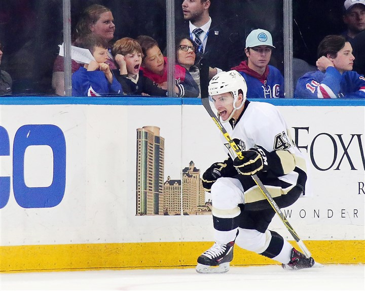 Pittsburgh Penguins v New York Rangers-4 Conor Sheary celebrates his second goal of the game against New York.