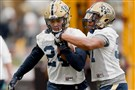 Pitt running back James Conner, left, runs a ball control drill with Qadree Ollison at practice March 15. Conner, who was diagnosed last year with Hodgkin lymphoma, will throw out the first pitch at the Pirates' season opener Sunday.