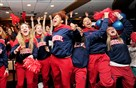 Members of the Duquesne women's basketball team celebrate as their name is announced among the field for the NCAA tournament Monday at a watch party at the Rivertown Hall of Fame Club at PNC Park.